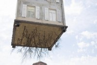 Why is this house Dangling From The Arm Of A Crane?
