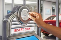 This 5-Story Glass car merchandising computing device Is Coin-Operated