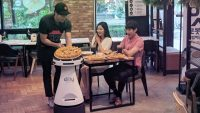 Pizza Hut has a new robot waiter in Korea, and we're booking a ticket to Seoul