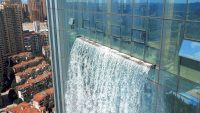 This wild new skyscraper is topped with a functioning waterfall