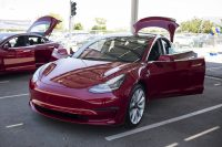 Tesla is hand-delivering the Model 3 to speed up sales