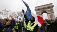 France to freeze fuel tax in concession to the Yellow Vests protest