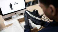 Foot Locker pours $100M into sneaker resale startup GOAT