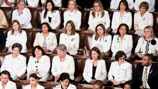 Progressive women are wearing white. They should wear purple and yellow, too