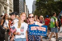 'Now Pay Us!' Photos from NYC's World Cup victory parade capture a mood—and a movement