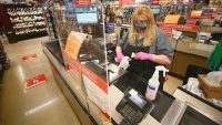 Grocery stores are starting to end hazard pay, but grocery workers are still getting sick