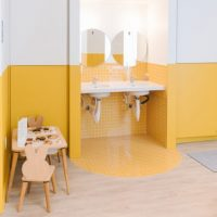 Work peacefully with your kid in the next room? This sleek coworking space is selling exactly that