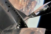 Virgin Galactic completes rocket-powered test flight after months of delays